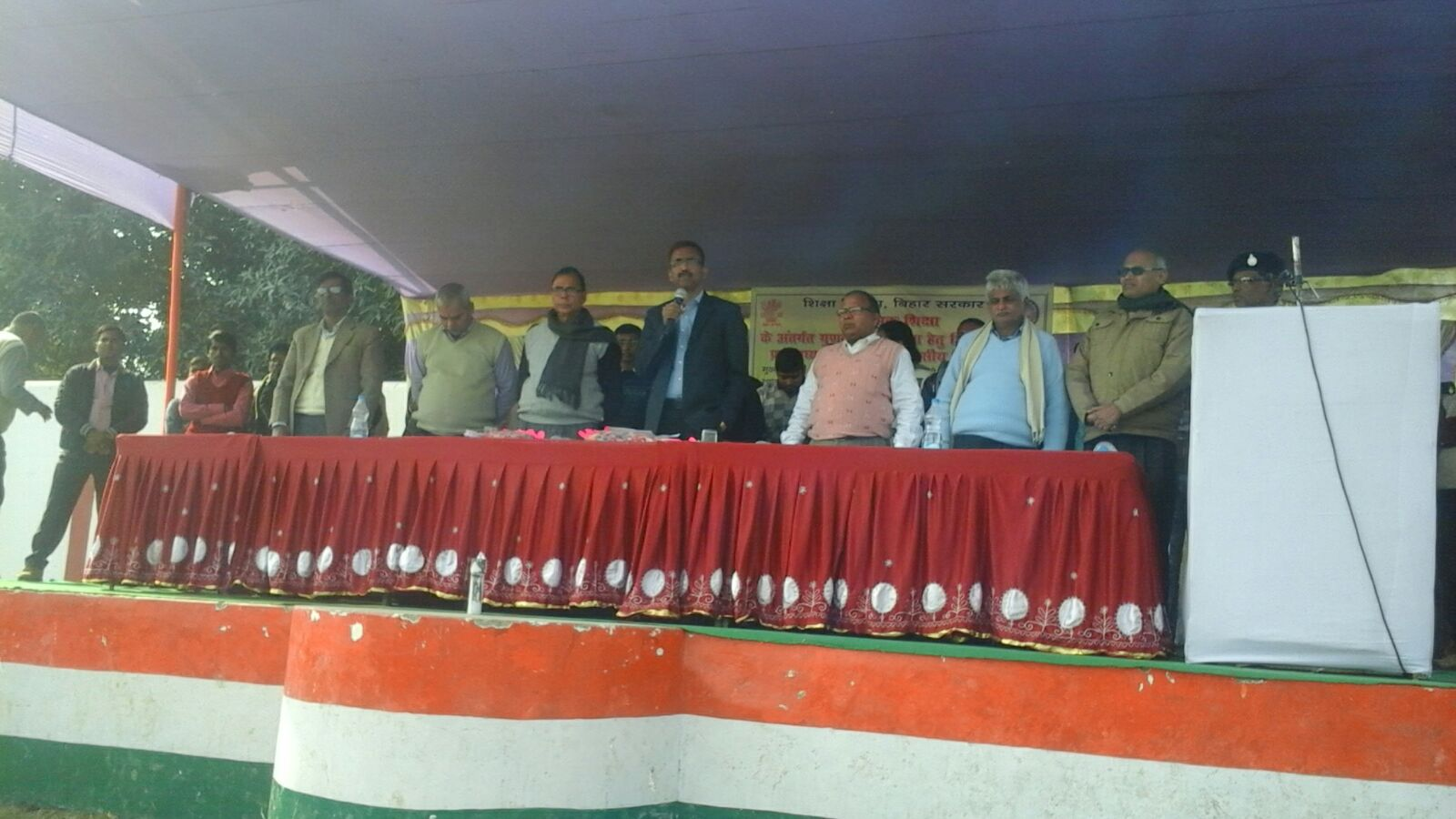 DM Md.Sohail, Dr.Madhepuri and others standing in a Shapathgrahan Ceremony .