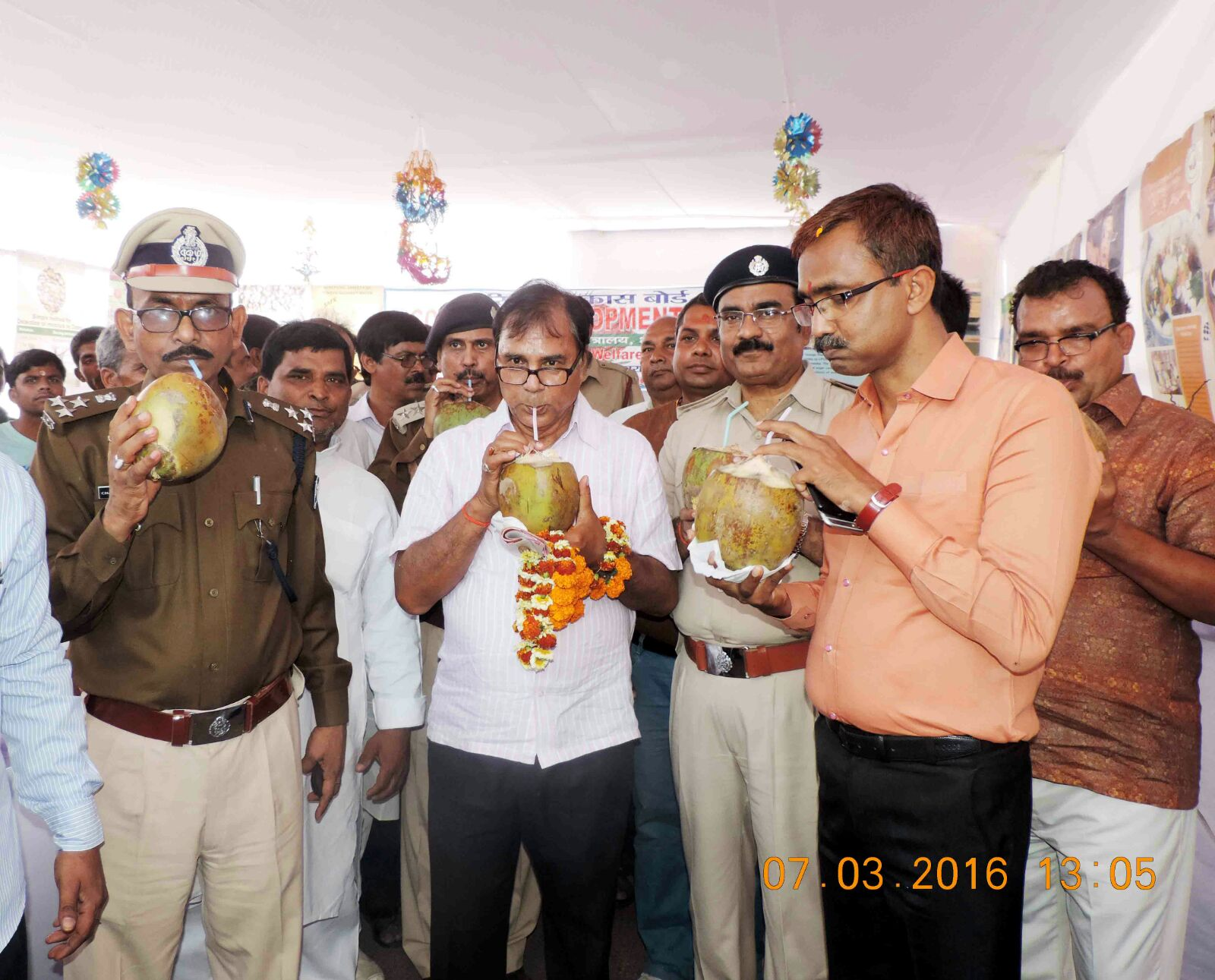 From L to R - DIG Chandrika Prasad, Dr. Madhepuri, SP Vikas Kumar, DM Md. Sohail, SDM Sanjay Kumar Nirala enjoying coconut water in Mela campus after inauguration of Coconut Stall.