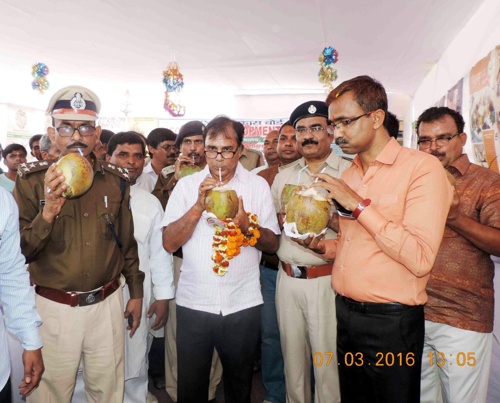 From L to R - DIG Chandrika Prasad, Dr. Madhepuri, SP Vikas Kumar, DM Md. Sohail, SDM Sanjay Kumar Nirala enjoying coconut water in Mela campus after inauguration of Coconut Stall.