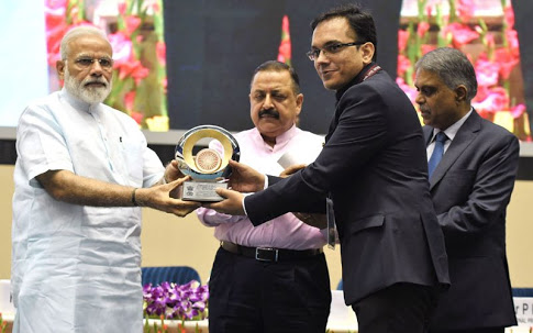 MD of South Bihar Power Distribution Mr.R.Laxman and DM of Nalanda Dr.Tyagarajan receiving Prizes from Honorable Prime Minister Narendra Modi at Vigyan Bhawan New Delhi .