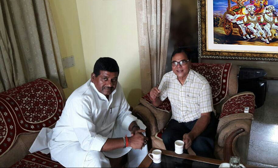 Newly Elected MLC Dr.Sanjeev Kumar Singh receiving blessings from Dr.Bhupendra Madhepuri at his residence (Vrindavan) Madhepura and discussing the problems of Vittrahit Shikshak .