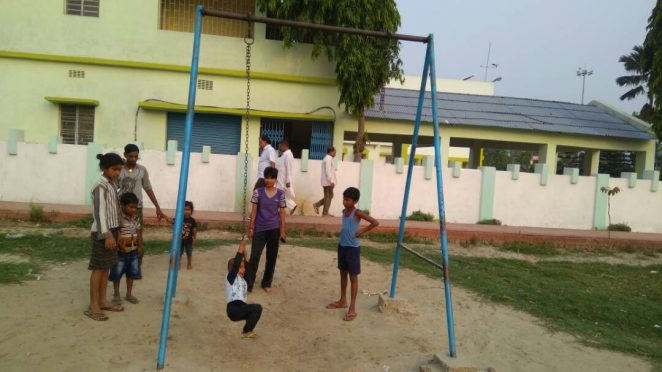 International Karate Player Miss Soniraj watching her niece and other children waiting for their turn near the ruptured swinging rope inside Circuite House Park at Madhepura.