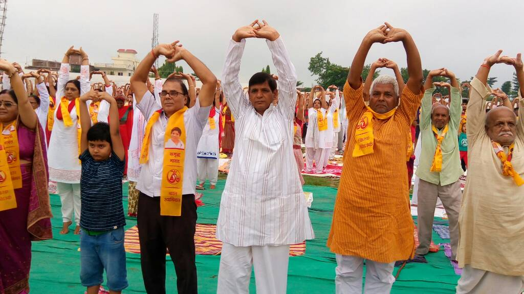 From L to R Zila Parishad Adhyaksha Smt.Manju Devi , Aditya , Dr.Bhupendra Madhepuri , Dr.Arun Kumar , Dr.Suresh Pd Yadav and Uttam Prasad Yadav etc attending 3rd International Yoga Shivir at BN Mandal Stadium Madhepura