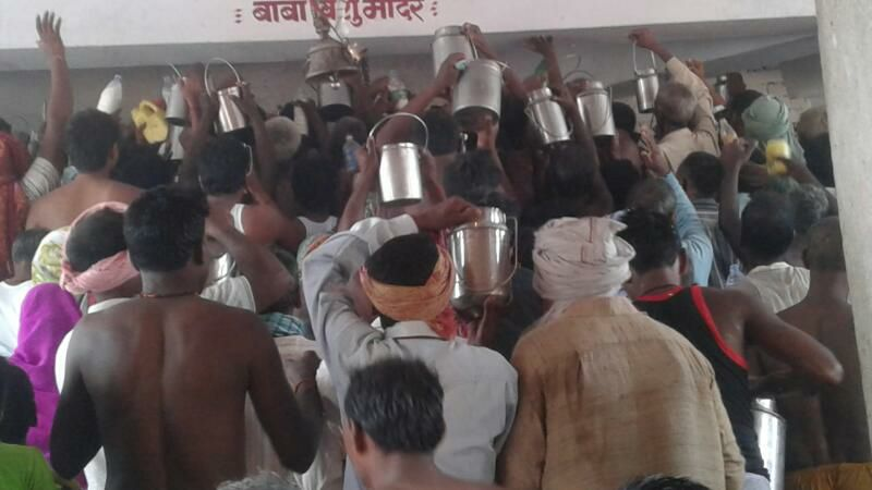 Devotees offering Raw Milk at Baba Vishuraut Temple.