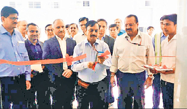 Honourable Member of Railway Board Mr.Ghanshyam Singh and The Authority of Alstom Company Mr.B.Salhotra jointly inaugurating Block Hostel Building (One) along with DRM Mr.R.K.Jain, Senior DEN Mr.Sanjay Kumar , D.O.M. Mr.Parmodh Kumar D.S.T.E. Saurabh Kumar, T.E. Mr.Kunwar Jha, P.W.I. Mr.Sunil Kumar & others in the campus of Rail Engine Factory at Madhepura.
