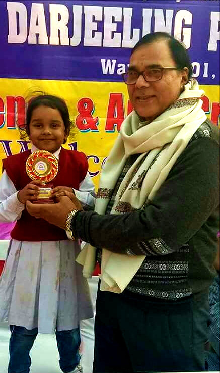 Evergreen Laughing kid from Darjeeling Public School receiving memento from Educationist Dr.Bhupendra Narayan Madhepuri.