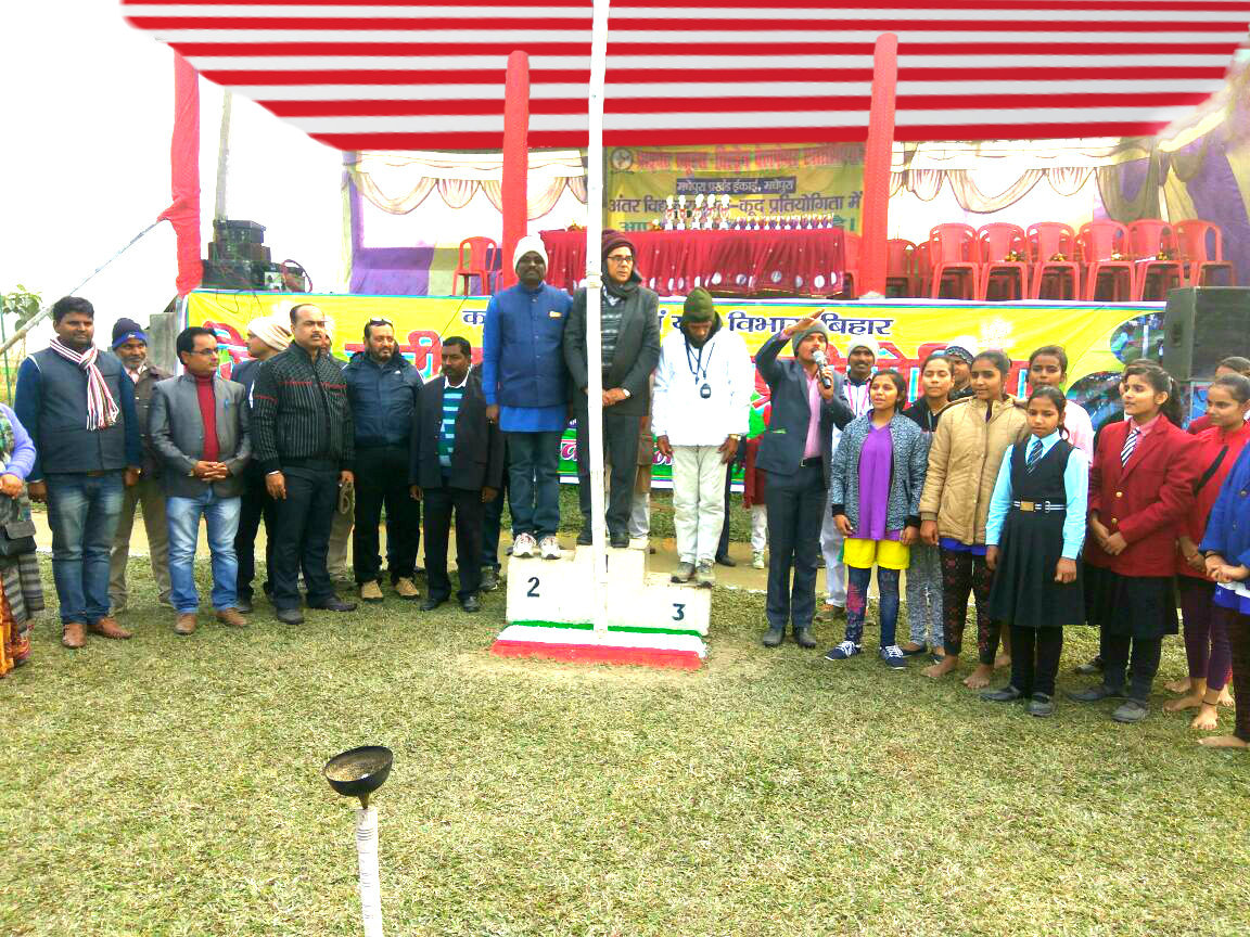 Educationist Dr.Bhupendra Madhepuri along with Private Schools Association Secretary Kishor Kumar, and Khel Guru Sant Kumar during flag hoisting at Kirti Krida Playground Madhepura.