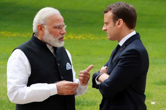 Prime Minister Narendra Modi and President of France Emmanuel Macron talking about Madhepura Rail Engine Factory.