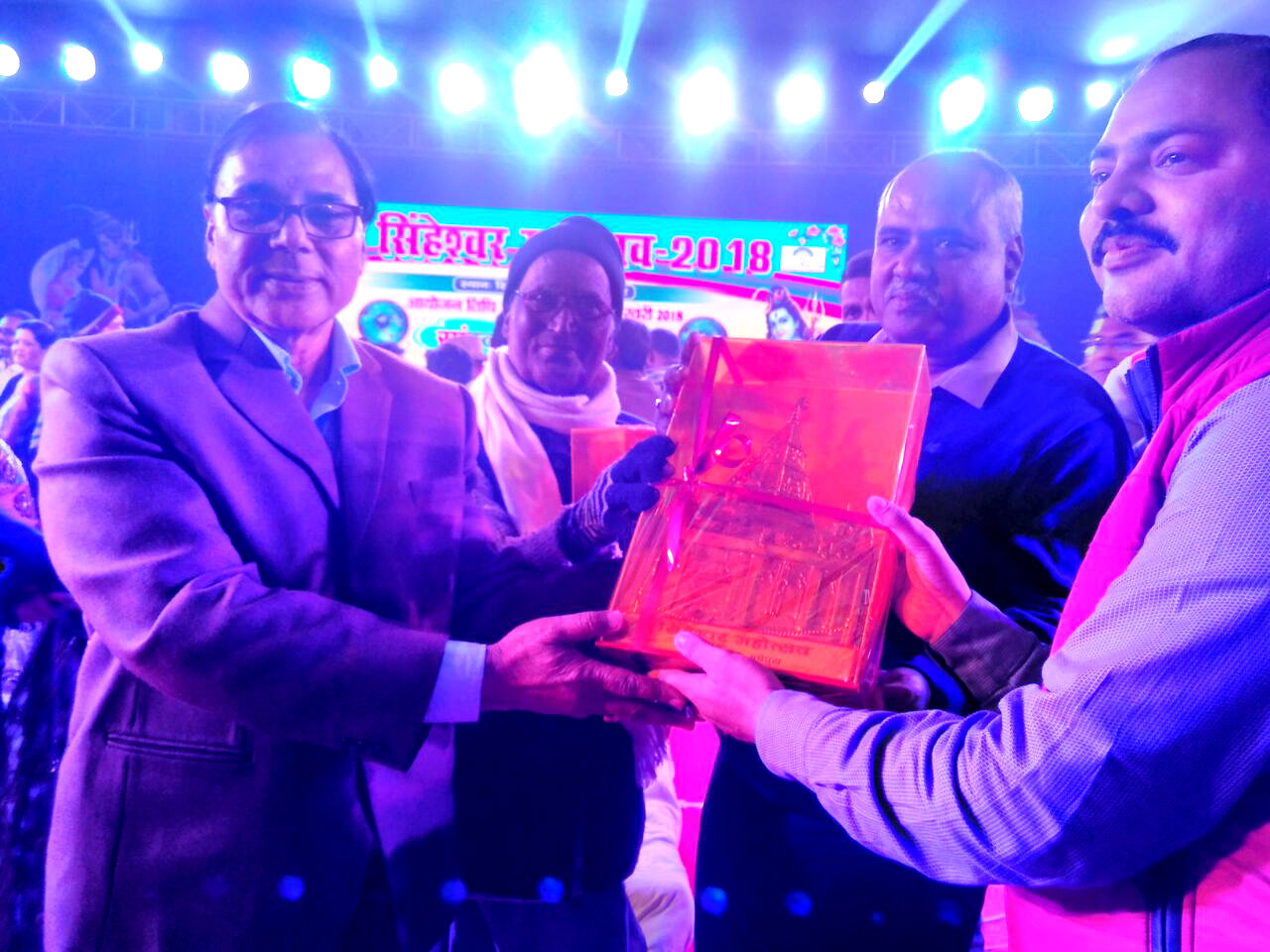 Samajsevi Dr.Bhupendra Madhepuri , President Awardee Prof.Y.N.Yadav and DDC Mukesh Kumar giving momento to NDC Rajneesh Roy for the best arrangements of Singheshwar Mahotsav 2018.