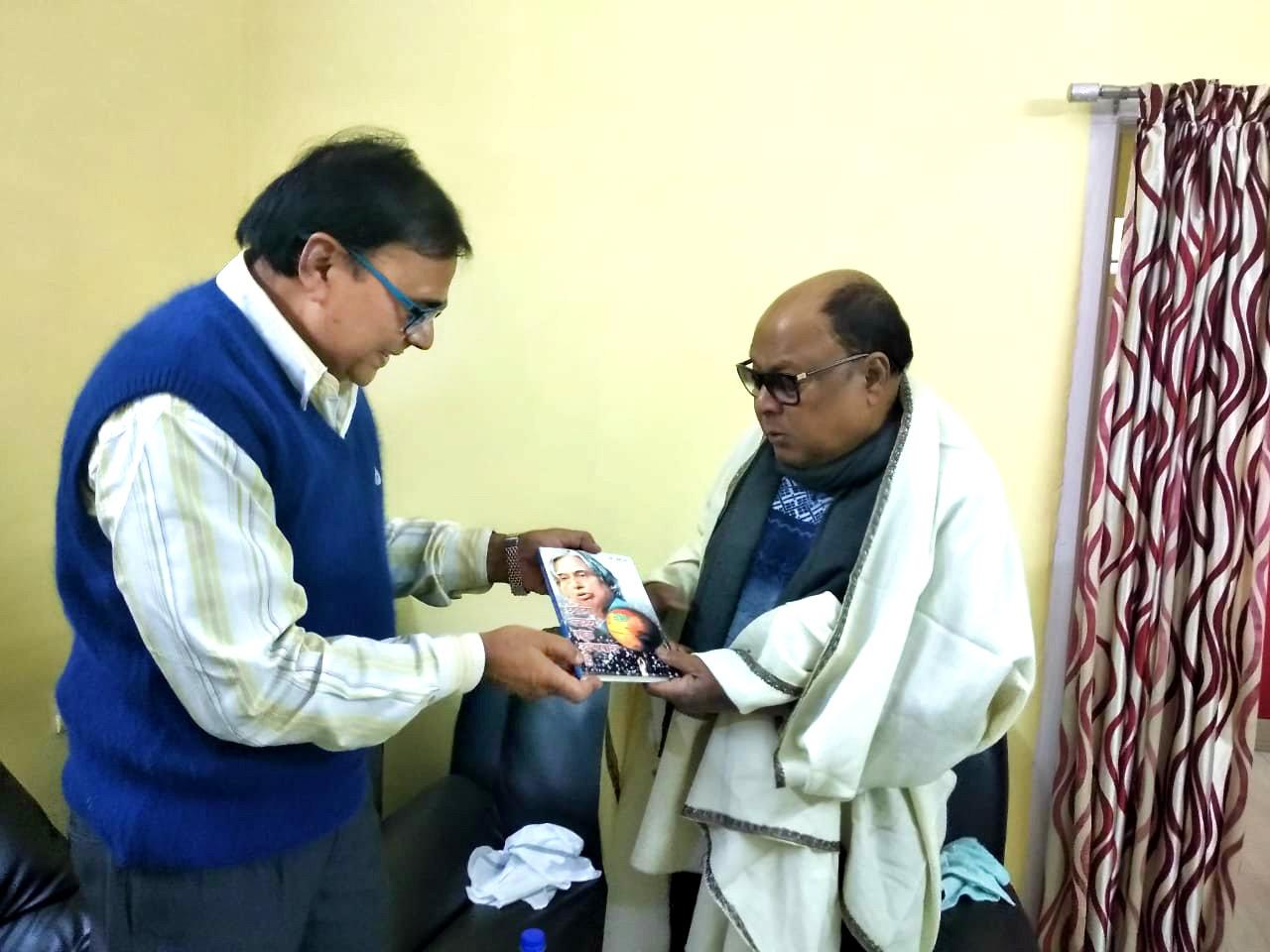 "Dr.Bhupendra Madhepuri presenting his book ""Chhota Lakshya Ek Apradh Hai"" to Md.Aziz."