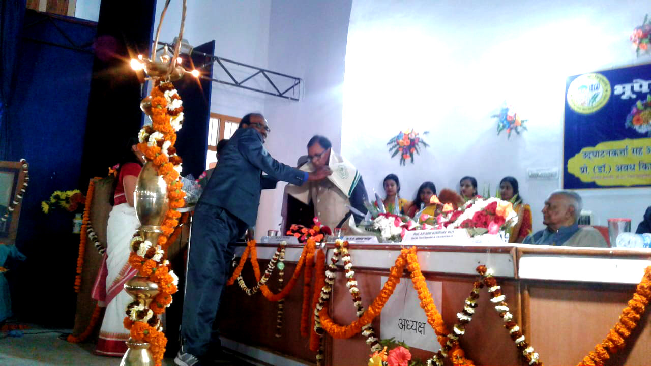 Dr.Bhupendra Madhepuri is being honoured at National Seminar, BNMU.