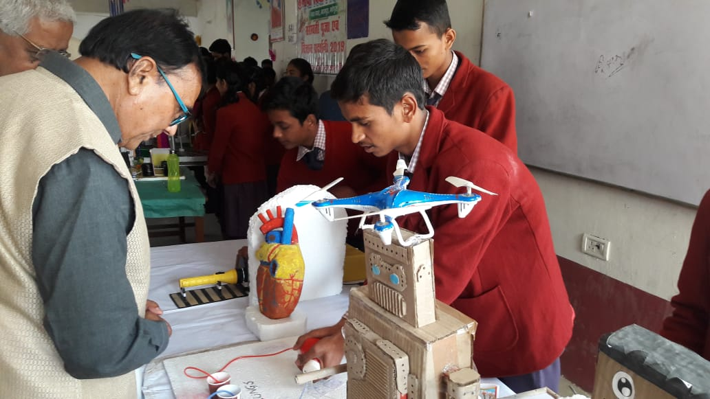 Dr.Bhupendra Madhepuri observing the creativity of students at Maya Vidya Niketan Madhepura.