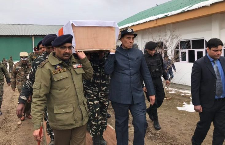 Home Minister Rajnath Singh carrying coffin of slain CRPF Soldier killed in Pulwama Attack.