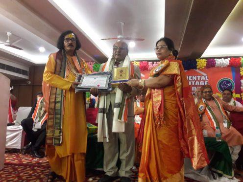 Dr.Shivmuni Yadav being honoured with Rashtriya Shiksha Ratna Award in Delhi.