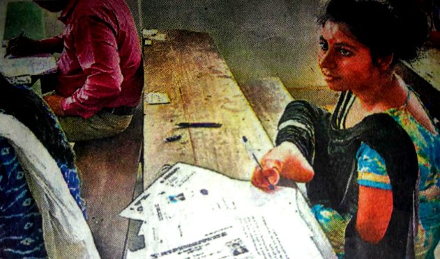Divyang Rupam writing in Pre-Ph.D. Exam by her leg at North Campus BNMU Madhepura.