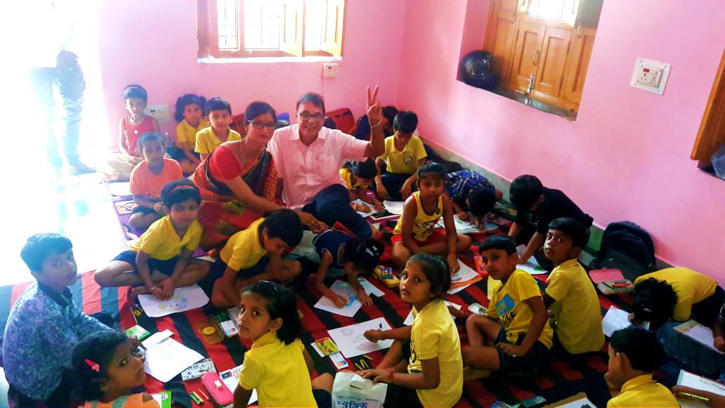 Dr.Madhepuri & Principal Dr.Hema Kashyap amidst kids.
