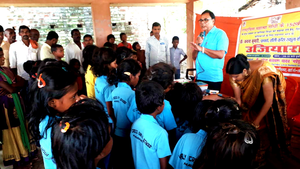 Dr.Madhepuri with Children, Teachers and Guardians making them understand the importance of Gandhi in our life .