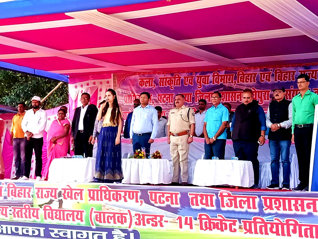 DM, SP, NDC, Dr.Madhepuri, LDM Ranjan Kumar Jha, Santosh Jha, Arun Kumar, Rekha Devi & others attending National Anthem with a baby singer Shivali.