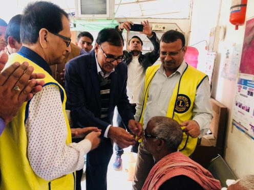 Dr.Bhupendra Narayan Yadav Madhepuri inaugurating the Eye Camp organised by Lion's Club by putting the spectacles to the patient