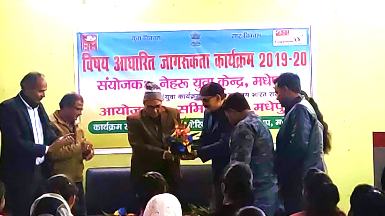 Chief Guest Dr.Bhupendra Madhepuri is being greeted by Bank Officer Santosh Kumar Jha and others at Chandra-Tara Hall, Samidha Group, Madhepura.