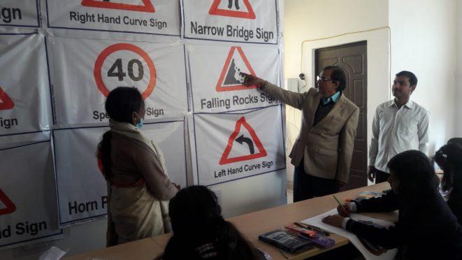 Samajsevi Dr.Bhupendra Madhepuri demonstrating rules of traffic rules on the occasion of Sadak Suraksha Maah at Samaharnalaya Madhepura.