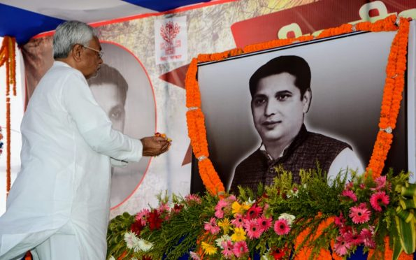 Chief Minister Nitish Kumar paying homage to BP Mandal at Murho , Madhepura on the occasion of 100th birth anniversary .