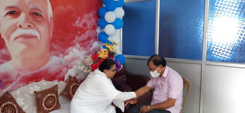 Brahmakumari Ranju Didi tieing Rakhi to Dr.B.N.Yadav Madhepuri on the occasion of Raksha Bandhan.